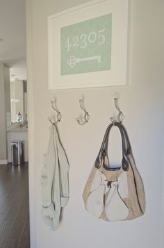 Love this look for a small entry way like ours! Nice art and useful hooks.