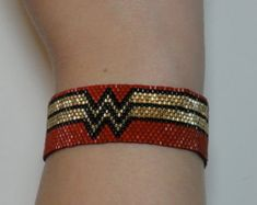 Wonder Woman NYCC Sparkling Japanese seed by DollyPopJewelryShop This is a fun Wonder Woman style bracelet made of seed beads and woven by hand off-loom. This bracelet will fit all wrists from 6 Seed Bead Jewelry, Bead Jewellery, Seed Beads, Beaded Jewelry, Bead Loom Patterns, Bracelet Patterns, Beading Patterns, Beading Ideas, Beading Supplies