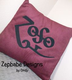 Led Zeppelin JP Dark Red Pillow Case 12x12     $25  Corduroy Fabric with iron on applique symbols https://www.learn2sewflorida.com/Zepbabe_Designs.html