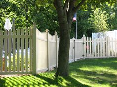 "Sunflower Picket Fence: Scalloped style, good neighbor vinyl picket fence with 3"" wide pickets. Available heights range from 36"" to 72"", and standard panel width is 96"". Dog ear picket caps are standard; spade caps are available upon request.  Assorted colors offered, including: White, Sandalwood, Adobe, Mocha, Honey Maple and Green Teak.  Looking for something a bit different? This fence can be customized to your unique needs!"
