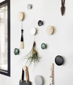 These wooden Dot wall hooks from Muuto are the same ones Sally used in her home.