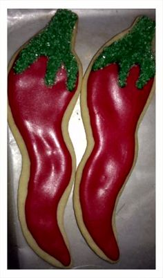 Fiesta Chili Pepper Sugar Cookies decorated with royal icing and green sugar sprinkles!