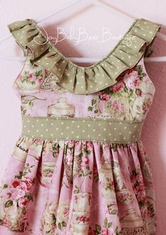 Toddler Tea Party and Easter Dress  With a tea-time print and soft green accents, This adorable little dress is perfect for Easter. Featuring a full