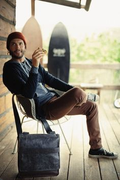 Cute guy, beard, surf boards, tuque, Converse, a cookie. I mean, seriously, what's not to like about this image?