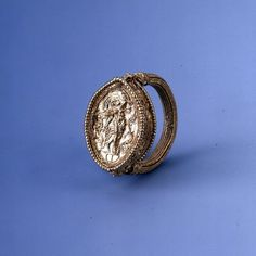 Gold Ring    330-300 BC    Found on Sicily    Gold bezel ring decorated with a maenad. Part of the Avola Hoard, found with 3004th century BC coins of Syracuse and Persia.