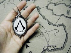Assassins Creed Logo Necklace Large by SuperfastSpider on Etsy, $15.99