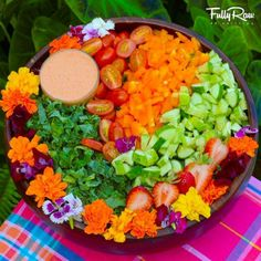 Tonight's Tropical Tican Salad!  Local greens with tomato, cucumber, bell pepper, strawberries, and edible flowers with a tomato tahini dressing! Taught my first class at the Epic RAWSTAR Retreat in Costa Rica today, making a 2-course meal for everyone while having close and personal time explaining the FullyRaw Lifestyle! More pics to come!  http://www.facebook.com/FullyRawKristina/