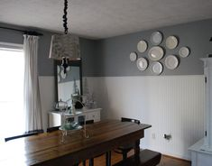 Gray and white dining room with antique dark wood table and chairs Beadboard Wainscoting, White Beadboard, Plates On Wall, Plate Wall, Dining Room Walls, Living Room, Grey Wall Color, Remodeling Mobile Homes, Grey Walls