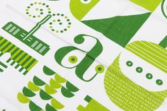 Patterned dark and light green tea towel