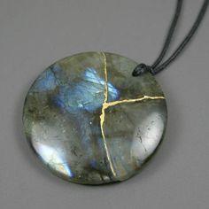 Kintsugi (kintsukuroi) labradorite stone round pendant with gold repair on black cotton cord by A Kintsugi Life