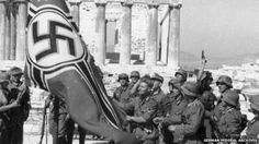 Does Germany owe Greece wartime reparations money? - German soldiers raising the German war flag over the Acropolis