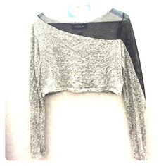 asymmetrical mesh sleeves crop top!! Worn once with a leather skirt to a rock themed party! Very cute but sassy! Mesh sleeve on one side. Bought from top shop Topshop Tops Crop Tops