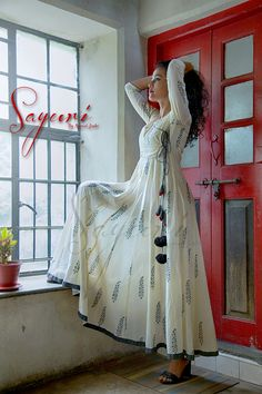 Printed mul Anarkali dress with grey border on the hem.
