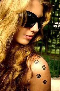 Paw prints tattoo