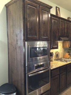 Love the wall oven/microwave and dark stained cabinets.