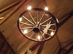 Wagon wheel lighting, at The Big Red Barn, New Windsor, Illinois.