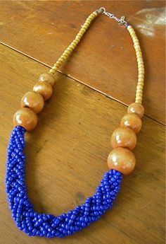 Long Blue Braided Bead and Light Wood Beaded Necklace. Get your wood bead DIY supplies at www.fizzypops.com