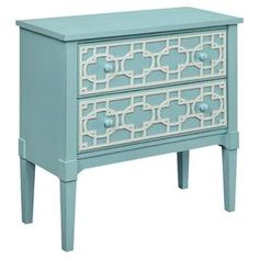"Featuring 2 lattice-front drawers and an eye-catching shore blue hue, this timeless chest brings classic appeal to any room.  Product: ChestConstruction Material: WoodColor: Shore blue and whiteFeatures: Hand-paintedTwo drawersDimensions: 34"" H x 35"" W x 16"" D"