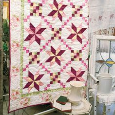 WEB BONUS:    Click here to download a FREE pattern for a bed size version of this Porcelain Stars quilt. (Problems downloading our PDF? Check out our troubleshooting tips.)    Skill Level  CONFIDENT BEGINNER    Finished Size  Lap Quilt 60½˝ x 70½˝  Web Bonus Bed Quilt 99½˝ X 99½˝    Featured Fabrics    Jennifer used assorted fabrics from her collection to make this quilt.