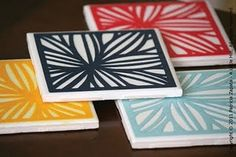 Coasters on tiles. Shelf lines used at the back and painted/craft sheets used at the top. Sealed with  modge podge.
