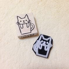 Cup Cat Rubber Stamp (This is the eraser stamp of cat making the perched face from the mug.)