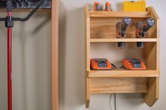 Cordless tools are great, but finding a place to keep their chargers and batteries can be a challenge. This wall-mounted station offers space for several chargers, plus storage for three drills. It's a great way to keep your cordless tools organized and ready to go.