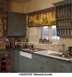 Built-in dishwasher and white sink in country kitchen with fruit-patterned blind and distressed paint effect cupboards Stock Image Living Room Remodel, Kitchen Remodel, Turquoise Kitchen Cabinets, Distressed Cabinets, Built In Dishwasher, White Sink, Country Kitchen, Cupboard, Blinds