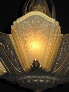 Beautiful detail on Art Decó slip shade lighting fixture.