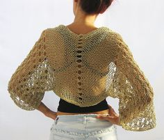 *************************************************************************** Elegant hand knitted shrug in natural beige, nude color. It is knitted with high quality cotton-acrylic yarn , that is very soft, lightweight and cozy. You can pair it with any sort of look. Wear it over jeans or