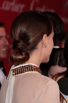 Natalie Portmans low, chignon hairstyle
