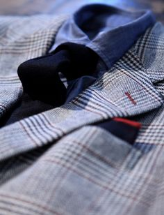 A denim effect cotton shirt and some details in red colour