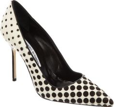 Manolo Blahnik calf hair pointed toe pump printed in a gradient dot pattern and detailed with smooth leather trim.
