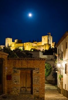 Full moon rising over the Alhambra in Granada, Andalusia, Spain