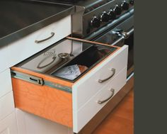 Tired of dried out bread but don't like the clutter of a bread box? Build one into your drawers and cabinets!  Build your custom Black Hills home with the folks at CustomHomesbyJScull.com. Contact us today!