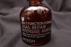 Mizon Snail Repair Intensive Ampoule. repair skin damage, lighten dark spots, reduce the appearance of pores and fine lines, and provide moisture