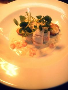 Salmon mousse, plaice fillets, sliced fried potatoes served with a creamy prawn sauce