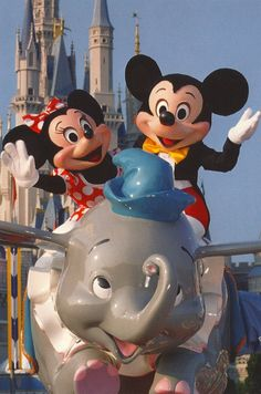 Mickey and Minnie riding Dumbo.