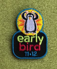 Girl Scout 100th anniversary year early bird patch. 11-12. Penguin.
