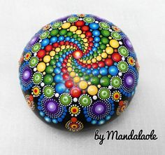 NEW Collection 2016.- Jewel drop whirlpool Hand Painted Mandala Stone. This piece is genuine, unaltered beach stone personally hand collected on the beaches of Gran Canaria, Spain. Paint includes point to point using various vibrant colors. The painting is applied on a very special beach stone, using bright colors of acrylic paint with different tips sizes, patience and creativity, and given a spray of satine clear varnish (lead free) to prevent the paint from peeling (Acrylic paint is…