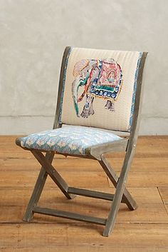 Elephant Terai Folding Chair, chosen for your boho lifestyle. Presented by Anthropologie for $198. #affiliate #bohohome #bohostyle