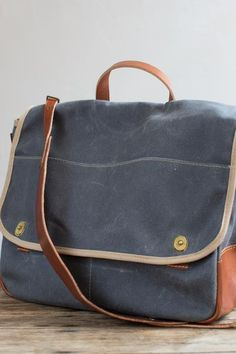 Inspired by English game bags and WWII musette bags, this messenger will stow your laptop, lunch, and even a sweater. Handmade in our Omaha studio. Holds a laptop Back pocket for magazines / tablet Storm resistant waxed twill Empty weight lbs Mini Messenger Bag, Brass Hardware, Laptop Bag, Bag Making, Leather Backpack, Fashion Backpack, Keys, Shoulder Strap, Wax