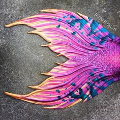 Love the blue colors used on this fluke.  Made by Finfolk Productions. #mermaid #mermaidtail #siliconemermaidtail