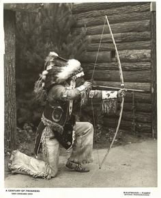 American Indian demonstrating the use of a bow and arrow at the Century of Progress Indian Village. Creator: Kaufmann & Fabry Co. Contributors: Century of Progress International Exposition..Date: ca. 1933-1934