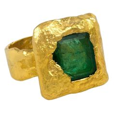 Jean Mahie Gold and Emerald Ring | From a unique collection of vintage fashion rings at https://www.1stdibs.com/jewelry/rings/fashion-rings/
