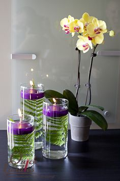 The contrast of the fern and the purple floating candle in this DIY design is breathtaking!