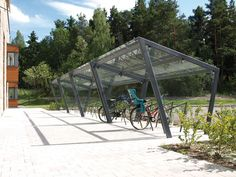 edge Bicycle shelter by mmcité Bicycle Garage, Bike Shed, Urban Architecture, Sustainable Architecture, Cycle Shelters, Bike Shelter, Carports, Shade Structure, Bike Parking