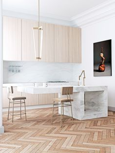 The above living room and this kitchen, in the same apartment, exemplify her pure, minimalist style.