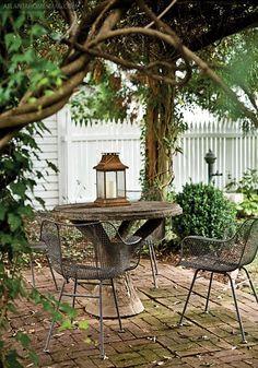 brick patio / metal furniture / lovely vines everywhere