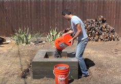 Place lava rock | Turn Your Backyard Into A Camping Area With This DIY Outdoor Fire Pit