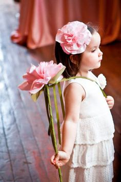 Instead of carrying a basket, have your flower girls carry a single stem of a similar flower to your bridal bouquet.